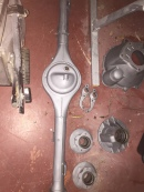 Diff housing, bellhousing, front hubs and ball joints were blasted and primed to be painted.