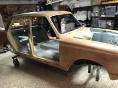 The outside of the car will be painted when it's back together. Makes assembly easier.